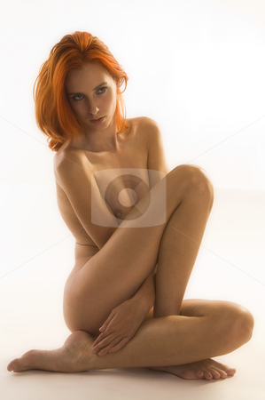 Naked woman folded up stock photo, Portrait of a naked model with bright red hair folded up by Frenk and Danielle Kaufmann