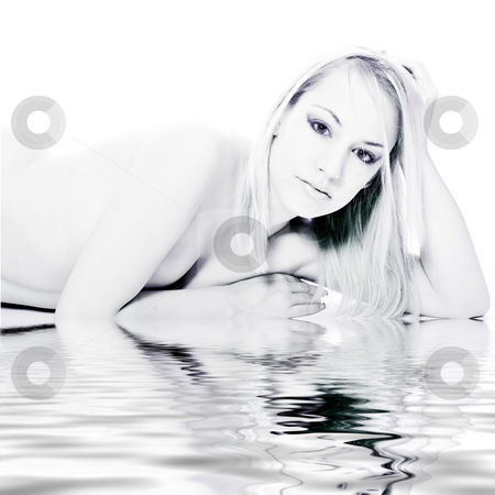 Studio portrait of a young blond woman lying by the water stock photo, Studio portrait of a young blond woman lying down naked by the pool by Frenk and Danielle Kaufmann