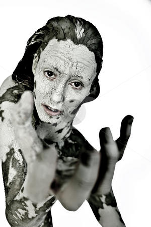 Begging by clay covered woman stock photo, Nude woman model covered in clay in the studio by Frenk and Danielle Kaufmann