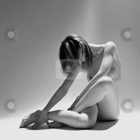 Artistic Nude stock photo, Studio portrait of a naked young woman making a shape with her body by Frenk and Danielle Kaufmann