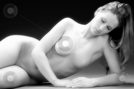 Nude waistshot stock photo, Young woman posing nude in the studio by Frenk and Danielle Kaufmann
