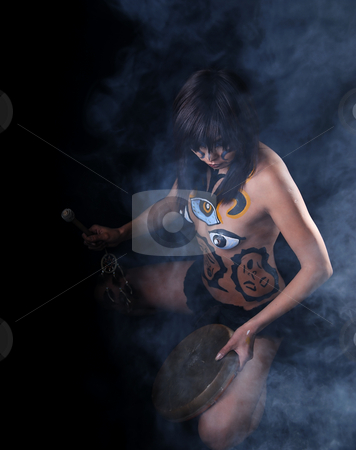 Contact with spirit limit stock photo, Girl with drawing on denuded tele does blows on drum by Vadim Maier