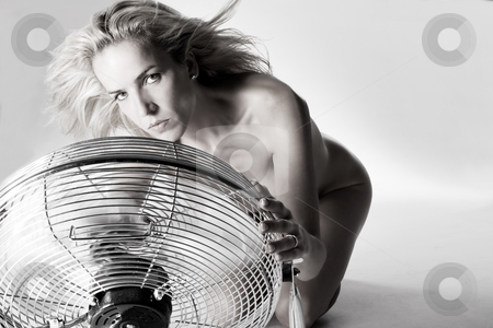 Blowing my hair stock photo, Portrait of a model sitting in front of a ventilator by Frenk and Danielle Kaufmann