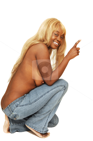 Young Jamaican girl. stock photo, An blond young Jamaican girl is posing in jeans and her nice long blond hair topless in front of the camera. by Horst Petzold