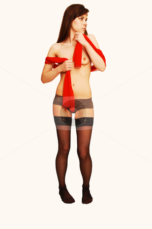 Young lady in underwear. stock photo, A young pretty lady standing in stockings bra and panties whit a red scarf on beige background. by Horst Petzold