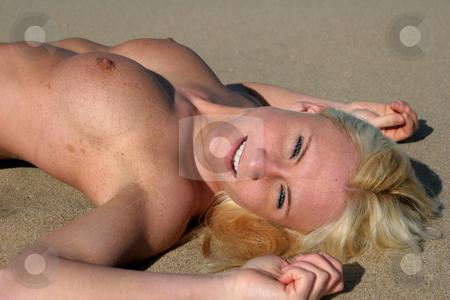 Bliss stock photo, Topless beauty relaxes on a beach (gunnison beach NJ) by Gregg Cerenzio