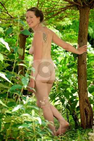 Naked young adult woman walking through the forest stock photo, Young adult woman nudist walking through the forrest by Frenk and Danielle Kaufmann