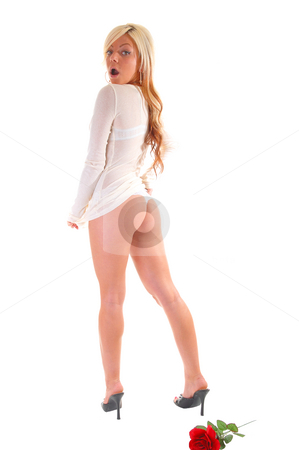 Pretty young girl. stock photo, A lovely young girl in an white sweater and thong, shooing her nice butt is surprised that somebody is seeing her so. by Horst Petzold