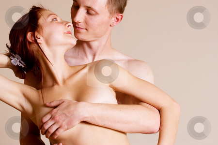 Couple #11 stock photo, Topless girl standing in front of her boyfriend - Looking at each other by Sean Nel