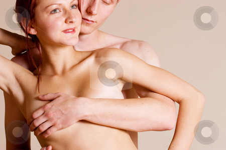 Couple #18 stock photo, Topless girl standing in front of her boyfriend - Looking away by Sean Nel