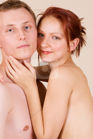 Couple #32 stock photo, Woman sitting on the lap of her boyfriend by Sean Nel