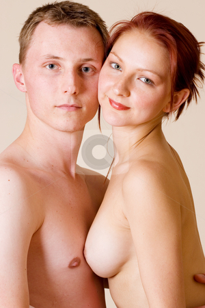 Couple #31 stock photo, Woman sitting on the lap of her boyfriend by Sean Nel