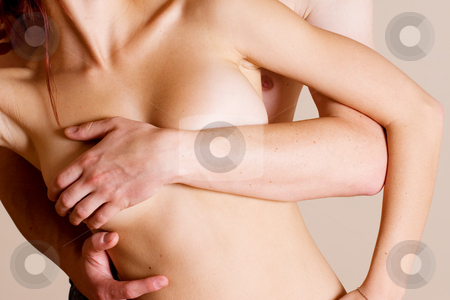 Couple #11 stock photo, Topless girl in white denim standing in front of her boyfriend by Sean Nel