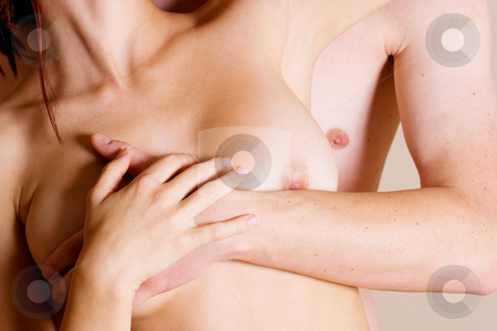 Couple #10 stock photo, Topless girl in white denim standing in front of her boyfriend by Sean Nel