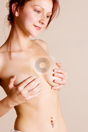 Breasts #7 stock photo, Naked woman with hands on breasts - Looking down by Sean Nel