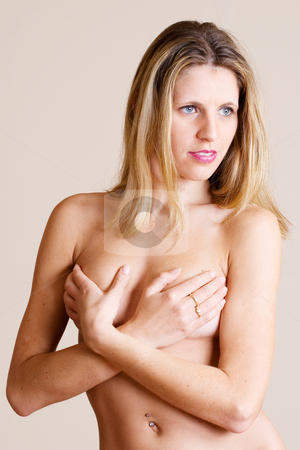 Woman #9 stock photo, Beatiful blonde woman covering her breasts with her hands by Sean Nel