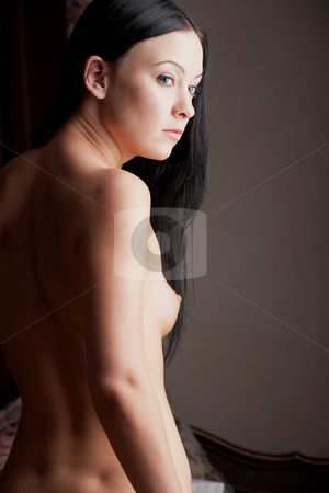 Naked young woman stock photo, Young adult Caucasian woman with black hair standing naked in her bedroom by Sean Nel