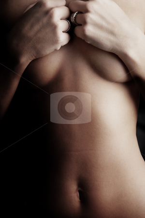 Naked young woman stock photo, Naked young adult caucasion woman holding on to her breasts by Sean Nel