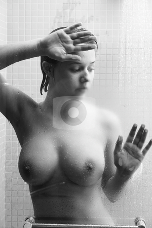 Woman in shower stock photo, Young caucasian adult woman in shower, leaning against the glass door in high contrast Black-and-White by Sean Nel