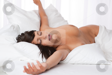 Sexy woman relaxing naked in white bed stock photo, Sexy woman relaxing ...