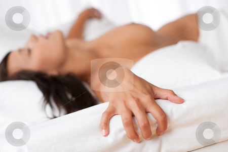 Naked Woman Lying In Bed Focus On Hand Stock