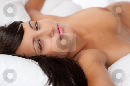 Sexy young woman lying naked in white bed stock photo, Sexy young woman ...